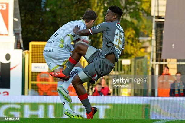 Goal-keeper Sammy Bossut of Zulte-Waregem and Michy Batshuayi of Standard in action during the Jupiler League match between Zulte Waregem and...