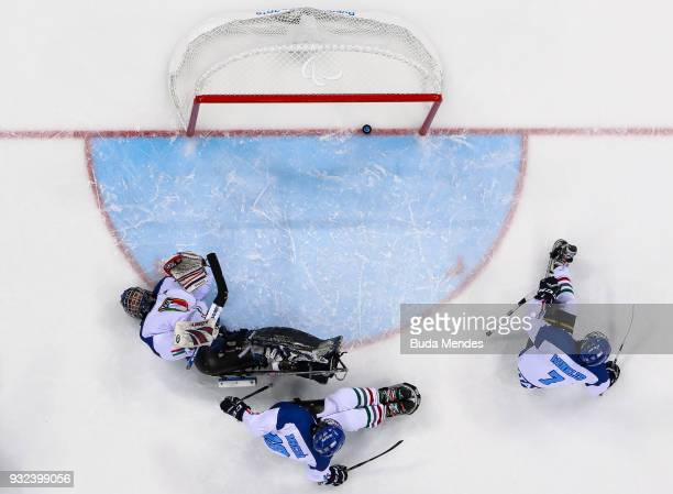 Goalkeeper Santino Stillitano of Italy looks dejected after he gets a goal in the Ice Hockey semifinals playoff game between United States and Italy...