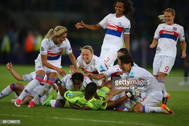 Goalkeeper Sarah Bouhaddi of Olympique Lyonnais is mobbed by her team mates after she scores the winning penalty during the UEFA Women's Champions...
