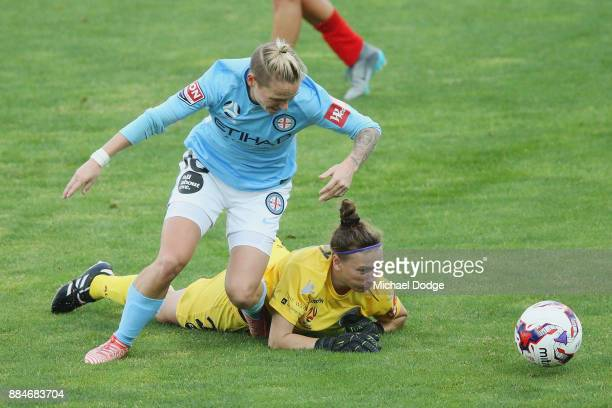 Goalkeeper Sarah Willacy of United gives away a penalty for this tackled on Jess Fishlock of the City during the round six WLeague match between...