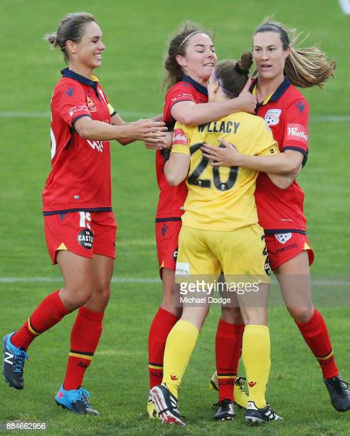 Goalkeeper Sarah Willacy of United is mobbed by teammates after saving a penalty attempt by Kyah Simon of the City during the round six WLeague match...