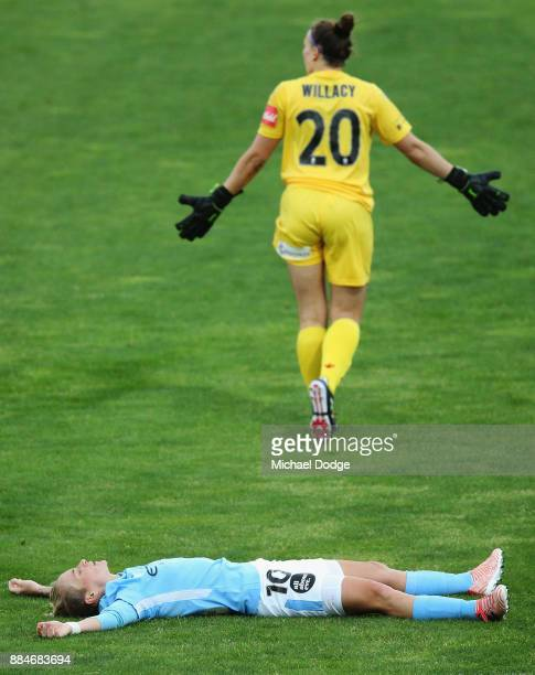 Goalkeeper Sarah Willacy of United reacts after giving away a penalty for a tackle on Jess Fishlock of the City who reacts during the round six...