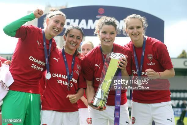 Goalkeeper Sari Van Veenendaal, Danielle Van De Donk, Dominique Bloodworth and Vivianne Miedema pose with the trophy during the Women's Super League...