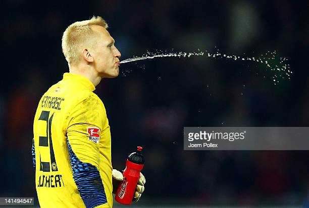 Goalkeeper Sascha Burchert of Berlin spits water after the Bundesliga match between Hertha BSC Berlin and FC Bayern Muenchen at Olympic Stadium on...