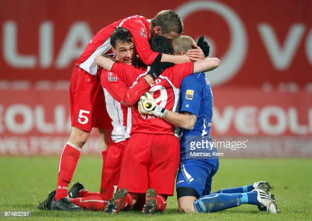 Goalkeeper Sascha Kirschstein of Ahlen celebrates with team mates after winning the Second Bundesliga match between FC Hansa Rostock and RotWeiss...