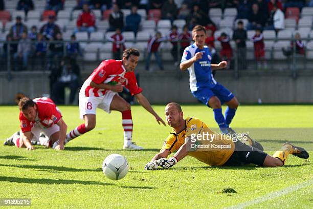Goalkeeper Sascha Kirschstein of Ahlen saves the ball during the Second Bundesliga match between RotWeiss Ahlen and Hansa Rostock at the Werse...