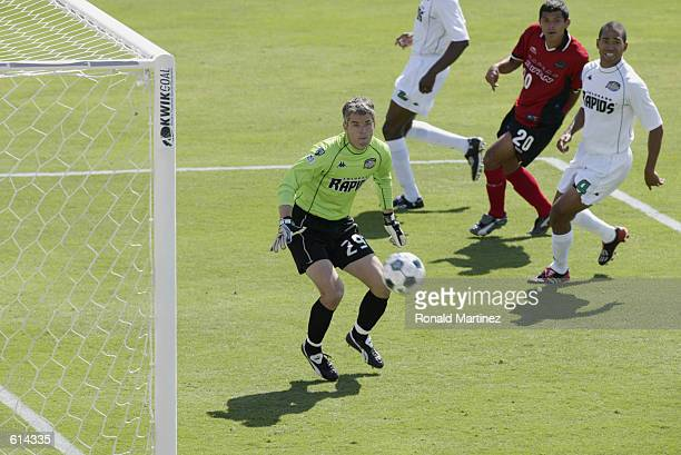 Goalkeeper Scott Garlick of the Colorado Rapids misses the save against Jason Kreis of the Dallas Burn as Robin Fraser of the Colorado Rapids and...