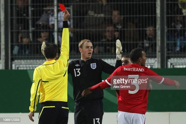 Goalkeeper Scott Loach of England is sent off by referee Christof Virant during the U21 international friendly match between Germany and England at...