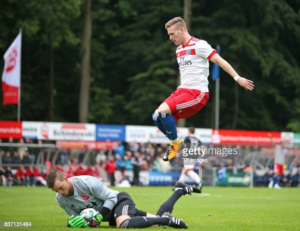 Goalkeeper Sebastian Lauridsen of Rotenburg and Andre Hahn of Hamburg battle for the ball during the preseason friendly match between Rotenburger SV...
