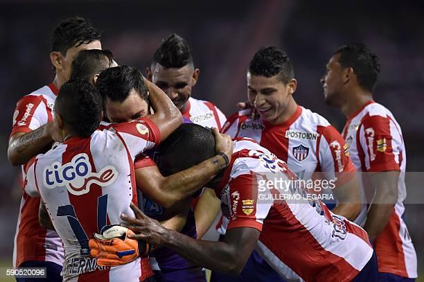 Goalkeeper Sebastian Viera of Colombia's Junior celebrates with teammates after scoring against Venezuela's Deportivo Lara during their firstround...