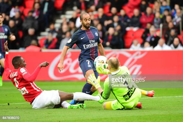 Goalkeeper Sergey Chernik of Nancy blocks a shot by Lucas Moura of PSG during the French Ligue 1 match between Paris Saint Germain and Nancy at Parc...