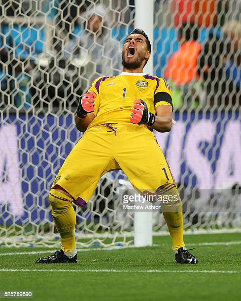Goalkeeper Sergio Romero of Argentina celebrates after saving the penalty from Wesley Sneijder of Netherlands and earning a place in the FIFA World...
