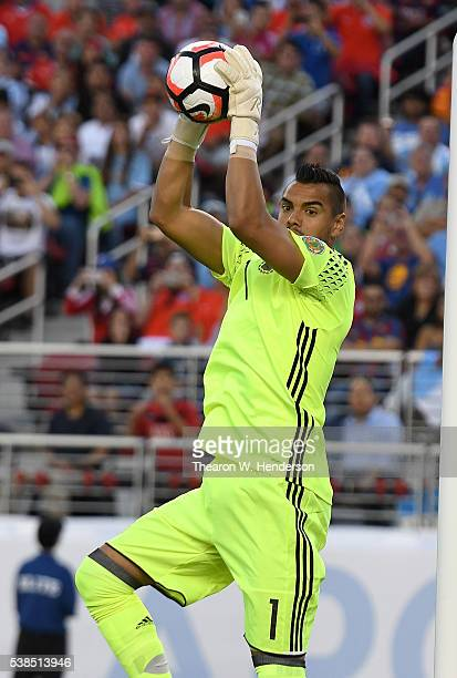 Goalkeeper Sergio Romero of Argentina leaps to make a save against Chile during the 2016 Copa America Centenario Group match play between Argentina...