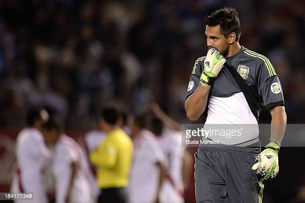 Goalkeeper Sergio Romero of Argentina reacts after receiving the goal during a match between Argentina and Peru as part of the 17th round of the...