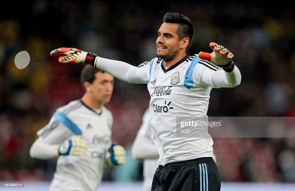Goalkeeper Sergio Romero of Argentina warms up prior to a match between Argentina and Brazil as part of 2014 Super Clasico at Beijing National Stadium on October 11, 2014 in Beijing, China.