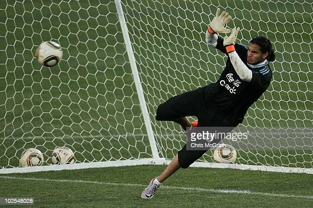 Goalkeeper Sergio Romero of Argentina's national football team blocks a shot during a team training session on June 30 2010 in Pretoria South Africa