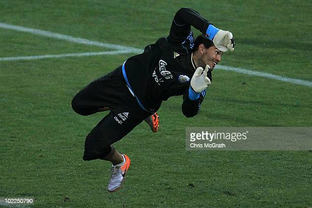 Goalkeeper Sergio Romero of Argentina's national football team watches as he misses a shot at goal during a team training session on June 20 2010 in...