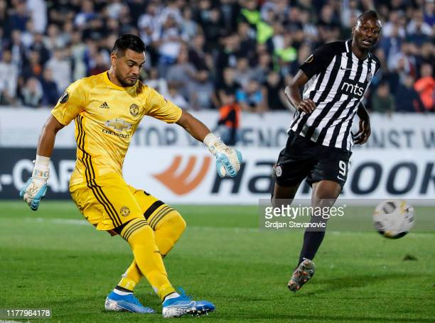 Goalkeeper Sergio Romero of Manchester United in action against Umar Sadiq of Partizan during the UEFA Europa League group L match between Partizan...
