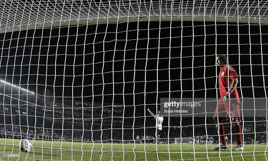 Goalkeeper Sergio Romero stares at the ball after failing to stop a penalty during a match between Argentina and Uruguay as part od the Quarter Fina of the Copa America 2011 at Brigadier Lopez Stadium on July 16, 2011 in Santa Fe, Argentina.