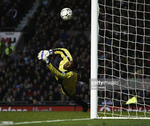 Goalkeeper Shaka Hislop of Portsmouth dives as Cristiano Ronaldo of Man Utd scores the second goal with a free kick during the FA Barclaycard...
