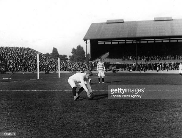 Goalkeeper Shaw of Queens Park Rangers picks up the ball
