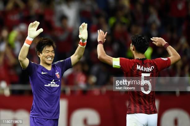 Goalkeeper Shusaku Nishikawa and Tomoaki Makino of Urawa Red Diamonds celebrate during the AFC Champions League Group G match between Urawa Red...