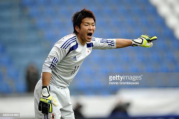 Goalkeeper Shusaku Nishikawa of Japan reacts during the International Friendly match between the Netherlands and Japan on November 16 2013 in Genk...