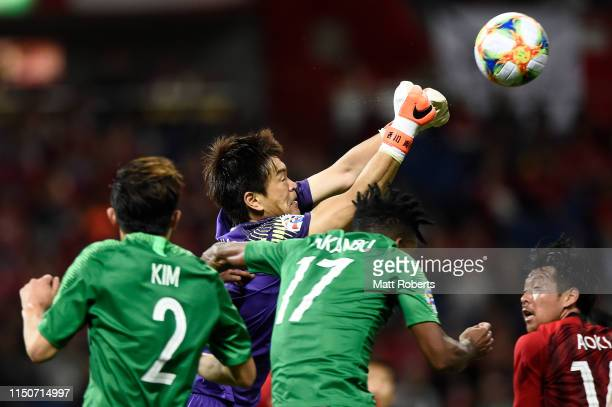 Goalkeeper Shusaku Nishikawa of Urawa Red Diamonds competes for the ball during the AFC Champions League Group G match between Urawa Red Diamonds and...