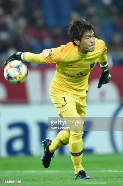 Goalkeeper Shusaku Nishikawa of Urawa Red Diamonds throws the ball during the AFC Champions League Group G match between Urawa Red Diamonds and...