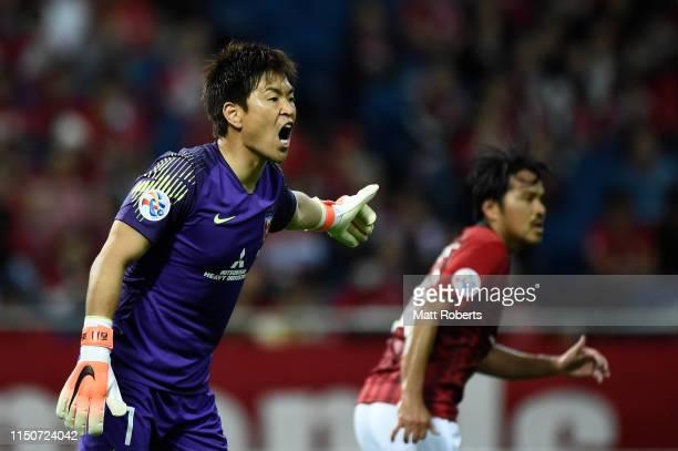 Goalkeeper Shusaku Nishikawa of Urawa Red Diamonds yells to his team mates during the AFC Champions League Group G match between Urawa Red Diamonds...