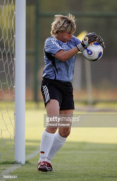 Goalkeeper Silke Rottenberg picks up a ball during the Women's German National Team training session on the training ground at the Wuhan Sports...