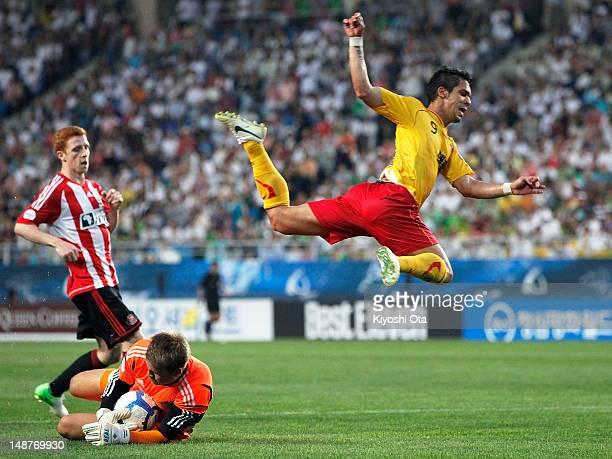 Goalkeeper Simon Mignolet of Sunderland makes a save on Everton Santos of Seongnam Ilhwa Chunma during the Peace Cup match between Seongnam Ilhwa...