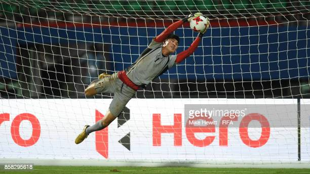 Goalkeeper Sin Tae Song makes a spectacular save during a Korea DPR training session at the Jawaharlal Nehru International Stadium ahead of the FIFA...