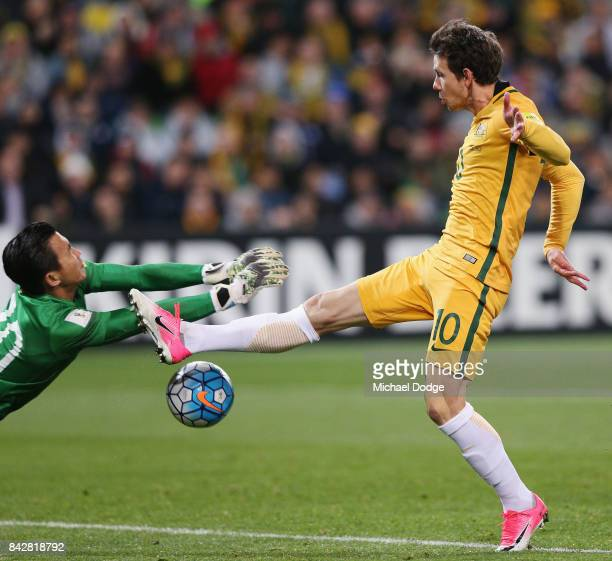 Goalkeeper Sinthaweechai Hathairattanakool of Thailand saves a goal attempt by Robbie Kruse of the Socceroos during the 2018 FIFA World Cup Qualifier...