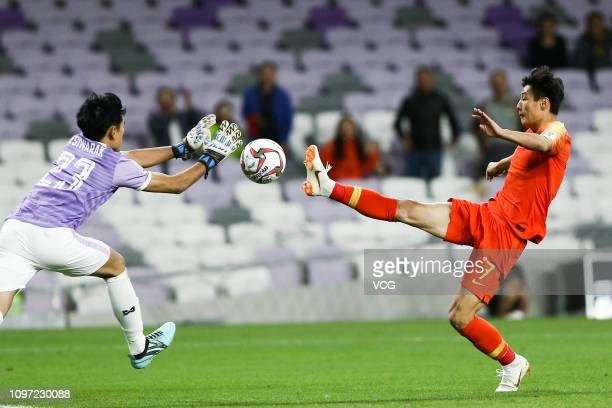 Goalkeeper Sivarak Tedsungnoen of Thailand and Wu Lei of China compete for the ball during the AFC Asian Cup round of 16 match between Thailand and...