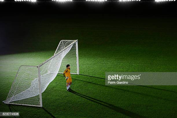goalkeeper standing at goalpost - goalkeeper stock pictures, royalty-free photos & images