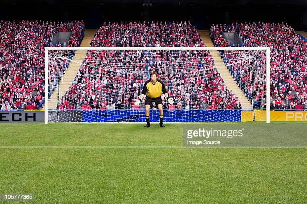 goalkeeper standing in goal - goal post stock photos and pictures