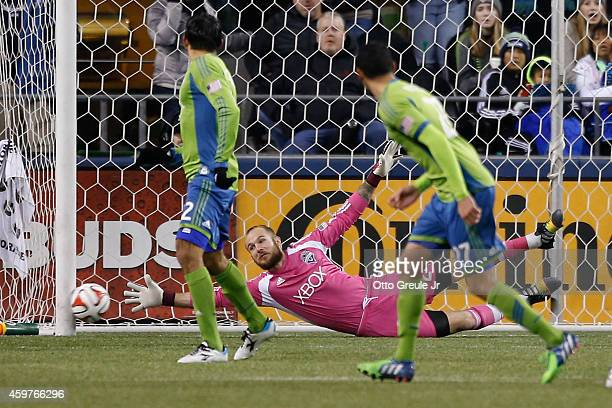 Goalkeeper Stefan Frei of the Seattle Sounders FC attempts to block a goal scored by Juninho of the Los Angeles Galaxy during the Western Conference...