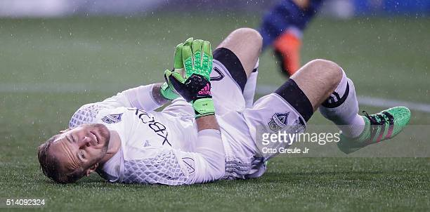 Goalkeeper Stefan Frei of the Seattle Sounders FC lies on the pitch after giving up a goal to Nuno Coelho of Sporting Kansas City at CenturyLink...