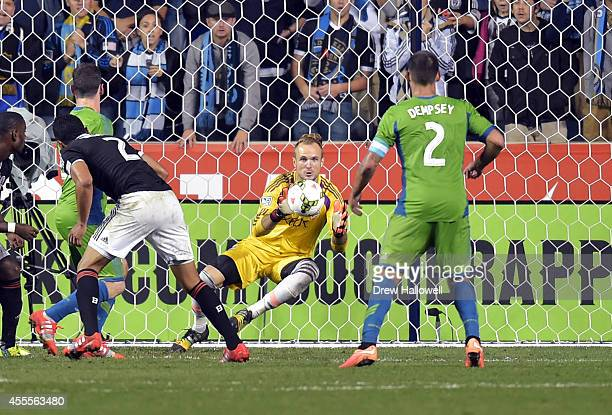 Goalkeeper Stefan Frei of the Seattle Sounders FC makes a save in front of teammate forward Clint Dempsey against the Philadelphia Union during the...