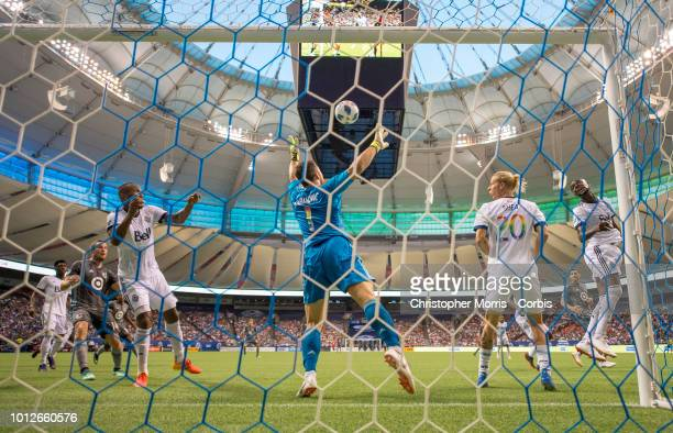 Goalkeeper Stefan Marinovic of the Vancouver Whitecaps reaches for the ball with teammates Kendall Waston Brek Shea and Kei Kamara at BC Place on...