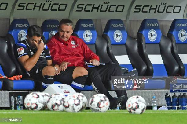 Goalkeeper Stefan Ortega Moreno and goalkeeper coach Marco Kostmann of Bielefeld sit on the substitutes bench during halftime of the Second...