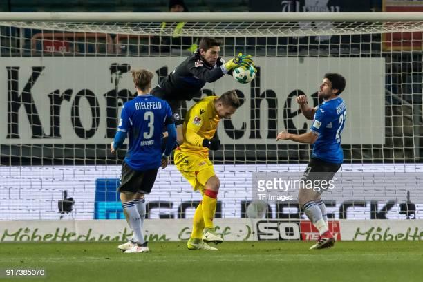 Goalkeeper Stefan Ortega of Bielefeld and Sebastian Polter of Berlin battle for the ball during the Second Bundesliga match between Arminia Bielefeld...