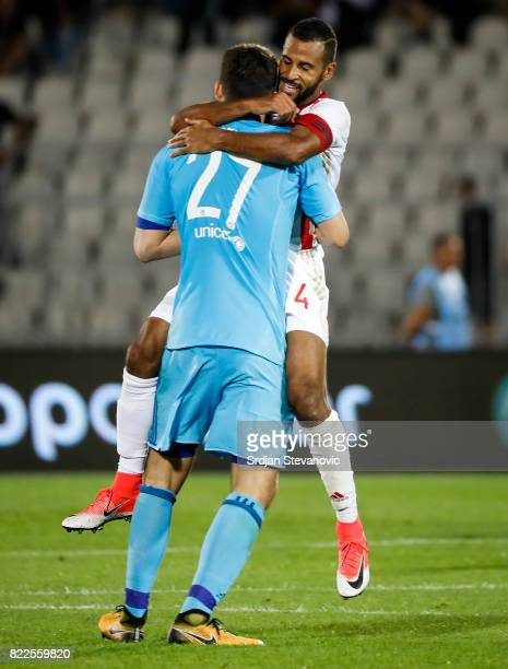 Goalkeeper Stefanos Kapino and Alaixys Romao of Olympiacos celebrate after the UEFA Champions League Qualifying match between FC Partizan and...