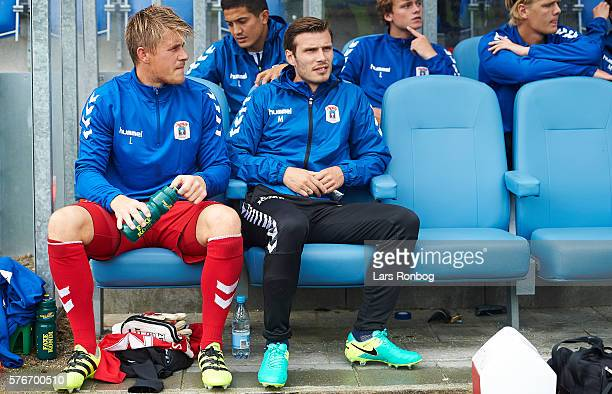 Goalkeeper Steffen Rasmussen of AGF Aarhus and Elmar Bjarnason of AGF Aarhus on the bench prior to the Danish Alka Superliga match between...