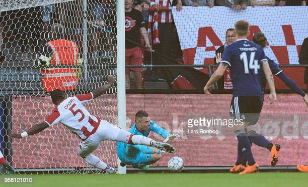Goalkeeper Stephan Andersen of FC Copenhagen and Jores Okore of AaB Aalborg compete for the ball during the Danish Alka Superliga match between AaB...