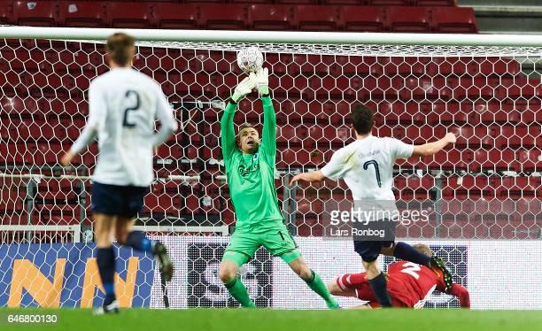 Goalkeeper Stephan Andersen of FC Copenhagen saves the ball from Sebastian Czajkowski of B93 during the Danish Cup DBU Pokalen match match between...