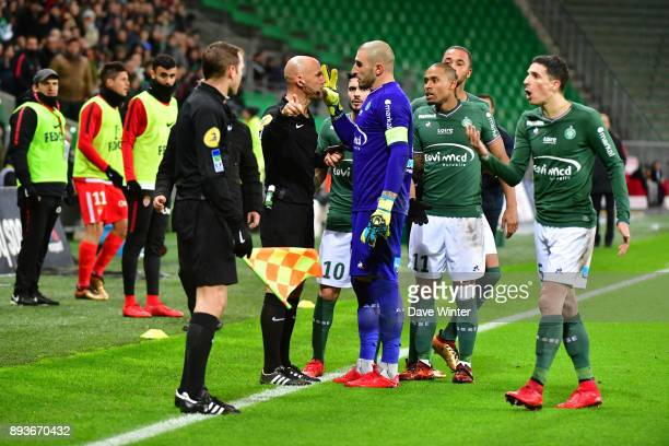 Goalkeeper Stephane Ruffier of St Etienne receives a red card from referee Amaury Delerue for his vigorous protest to the assistant referee after...