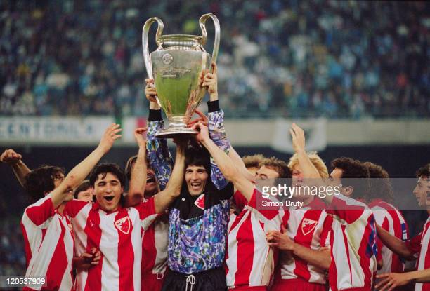 Goalkeeper Stevan Stojanovic, the captain of Red Star Belgrade, holds up the trophy with other members of his team at the Stadio San Nicola in Bari,...