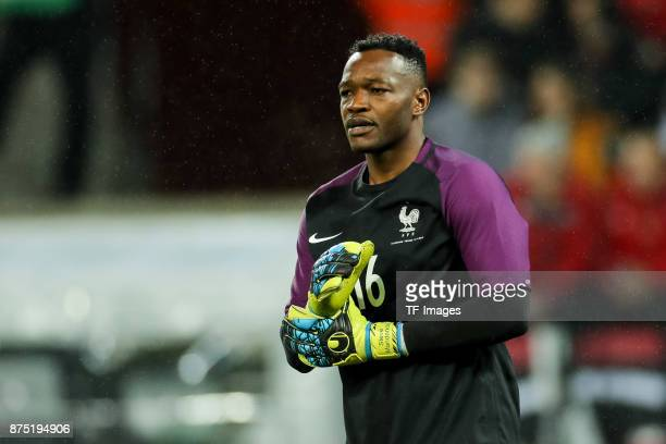 Goalkeeper Steve Mandanda of France looks on during the International friendly match between Germany and France at RheinEnergieStadion on November 14...